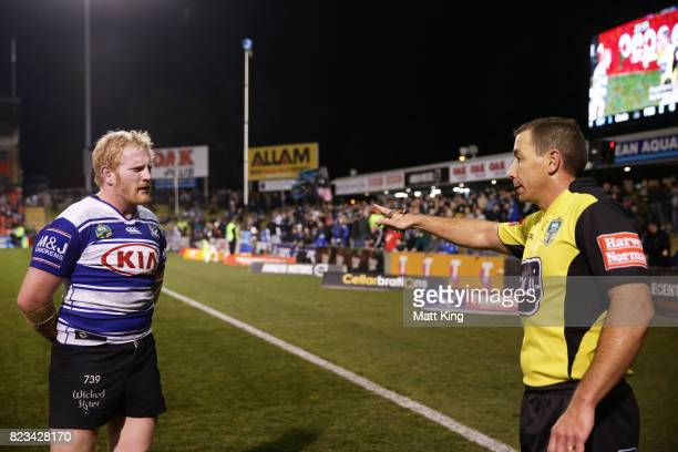 James Graham captain of the Bulldogs argues with referee Ben Cummins after the try to Dallin Watene Zelezniak of the Panthers during the round 21 NRL...