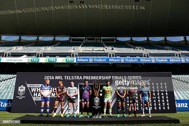 James Graham Corey Parker Paul Gallen Cameron Smith Jarrod Croker Jason Taumalolo Matt Moylan and Nathan Friend with the NRL Premiership Trophy...