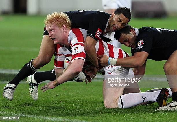 James Graham of England is tackled by Benji Marshall of the Kiwis defence during the Four Nations match between the New Zealand Kiwis and England at...