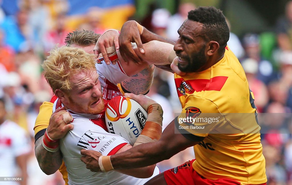 James Graham of England is tackled by Moses Meninga of the Kumuls during the 2017 Rugby League World Cup Quarter Final match between England and Papua New Guinea Kumuls at AAMI Park on November 19, 2017 in Melbourne, Australia.