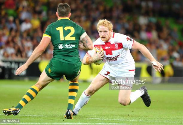 James Graham of England is tackled during the 2017 Rugby League World Cup match between the Australian Kangaroos and England at AAMI Park on October...