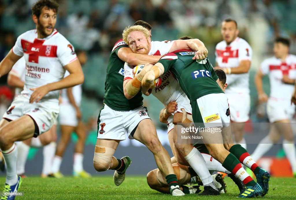 James Graham of England is tackled during the 2017 Rugby League World Cup match between England and Lebanon at Allianz Stadium on November 4, 2017 in Sydney, Australia.