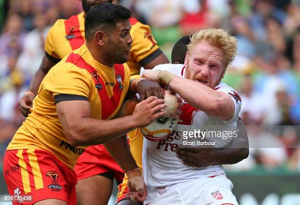 James Graham of England is tackled during the 2017 Rugby League World Cup Quarter Final match between England and Papua New Guinea Kumuls at AAMI...