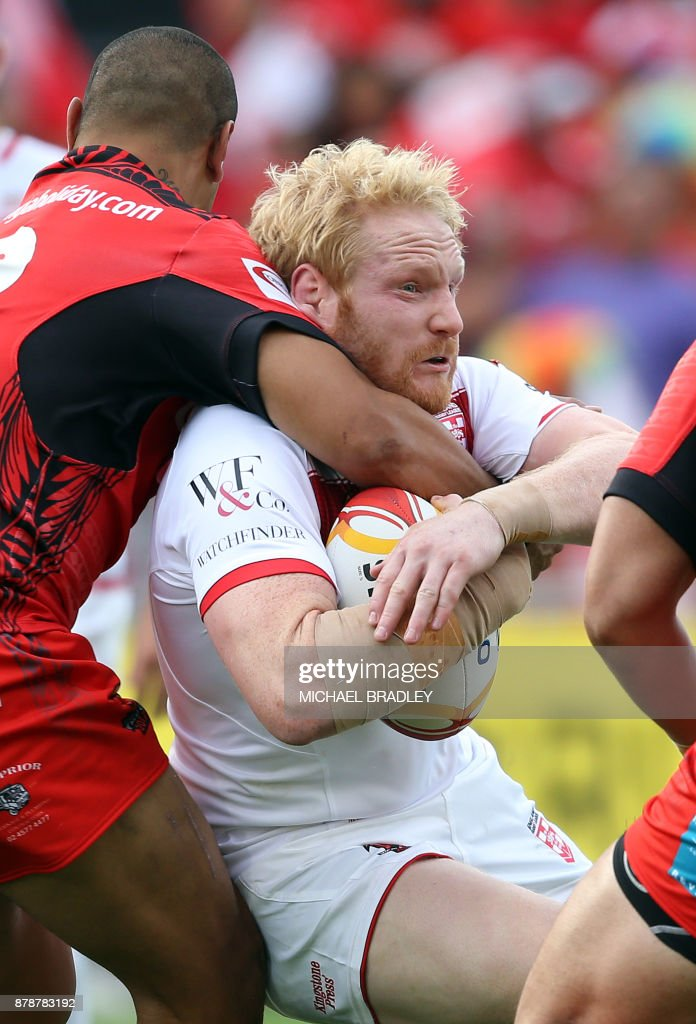 James Graham of England (C) is tackled during the Rugby League World Cup men's semi-final match between Tonga and England at Mt Smart Stadium in Auckland on November 25, 2017. /