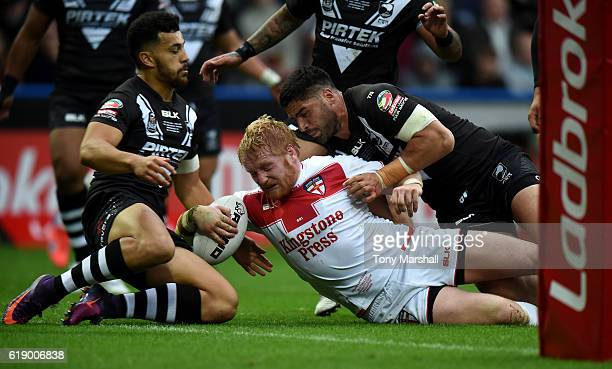 James Graham of England is tackled just short of the try line during the Four Nations match between the England and New Zealand Kiwis at the John...