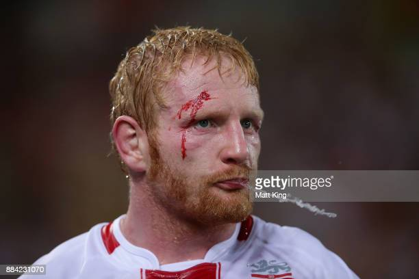 James Graham of England spits water during the 2017 Rugby League World Cup Final between the Australian Kangaroos and England at Suncorp Stadium on...