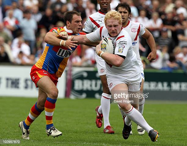 James Graham of St Helens holds off Luke Gale defence during the Engage Super League match between St Helens and Harlequins RL at Knowsley Road on...