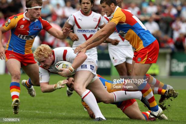 James Graham of St Helens is stopped by the Harlequins defence during the Engage Super League match between St Helens and Harlequins RL at Knowsley...
