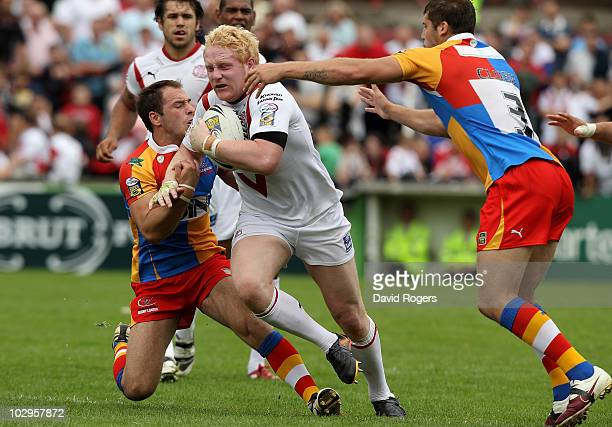 James Graham of St Helens is tackled by Luke Gale and Tony Clubb defence during the Engage Super League match between St Helens and Harlequins RL at...
