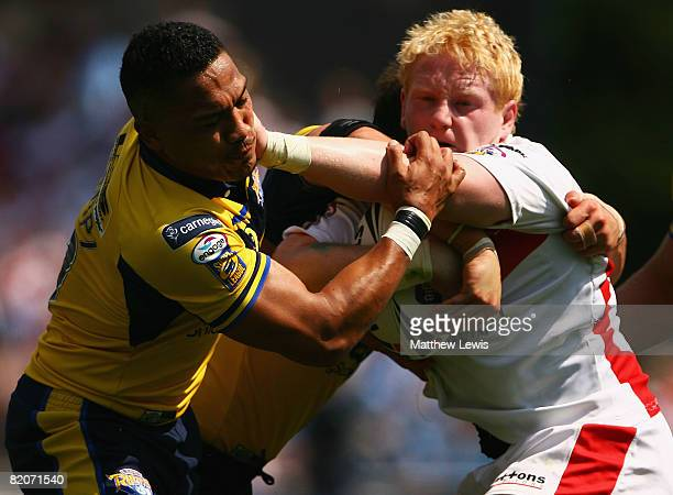James Graham of StHelens hands off Clinton Toopi of Leedsduring the Carnegie Challenge Cup Semi Final match between Leeds Rhinos and StHelens at the...