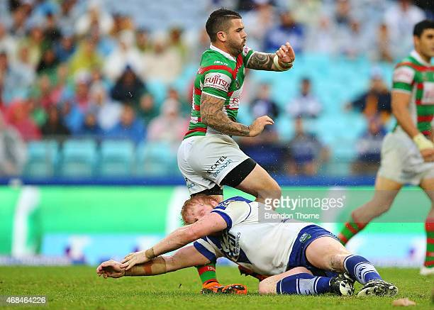 James Graham of the Bulldogs attempts a late tackle on Adam Reynolds of the Rabbitohs while attempting a field goal during the round five NRL match...