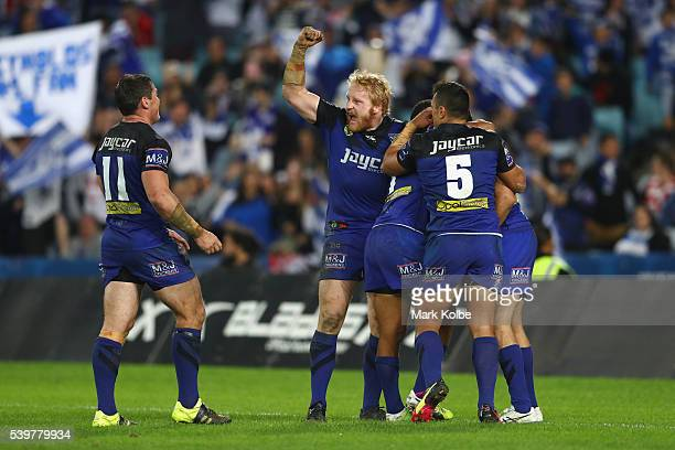 James Graham of the Bulldogs celebrates as the Bulldogs players congratulate Josh Reynolds of the Bulldogs after he scored a try during the round 14...