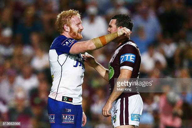 James Graham of the Bulldogs gestures with a forearm after a high tackle by Steve Matai of the Sea Eagles as Jamie Lyon of the Sea Eagles looks on...