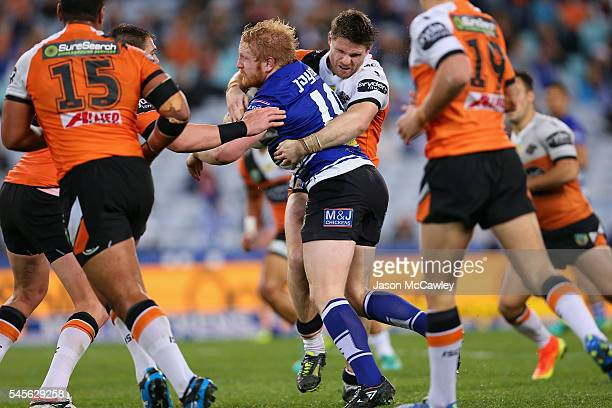 James Graham of the Bulldogs is tackled by Chris Lawrence of the Tigers during the round 18 NRL match between the Canterbury Bulldogs and the Wests...