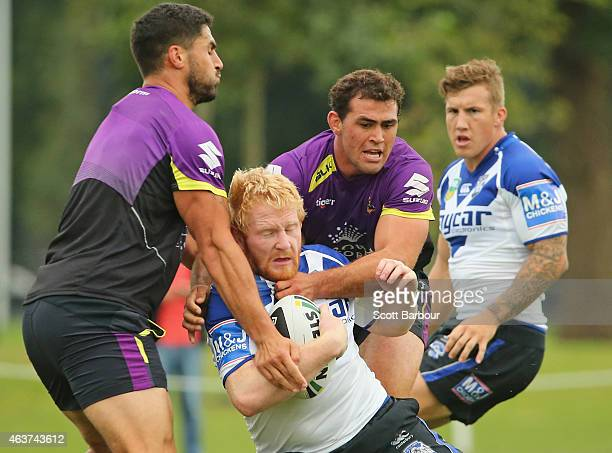 James Graham of the Bulldogs is tackled by Dale Finucane of the Storm during a joint NRL training session with the Melbourne Storm and Canterbury...