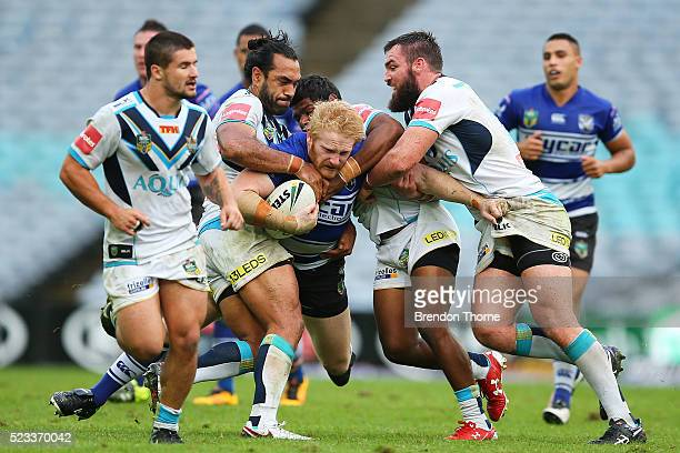 James Graham of the Bulldogs is tackled by the Titans defence during the round eight NRL match between the Canterbury Bulldogs and the Gold Coast...