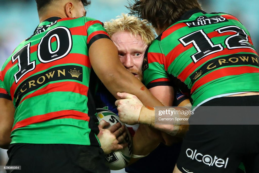 James Graham of the Bulldogs is tackled during the round 23 NRL match between the South Sydney Rabbitohs and the Canterbury Bulldogs at ANZ Stadium on August 10, 2017 in Sydney, Australia.
