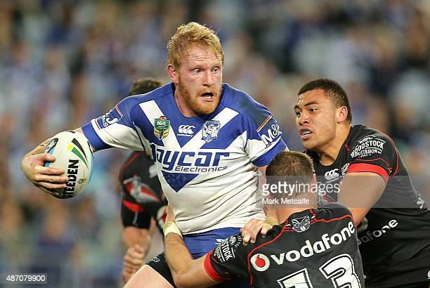 James Graham of the Bulldogs is tackled during the round 26 NRL match between the Canterbury Bulldogs and the New Zealand Warriors at ANZ Stadium on...