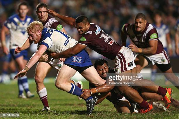 James Graham of the Bulldogs is tackled during the round 3 NRL match between the Manly Warringhah Sea Eagles and the Canterbury Bulldogs at Brookvale...