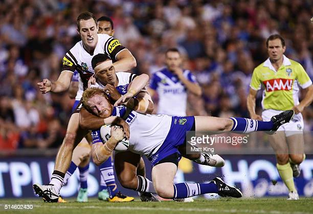 James Graham of the Bulldogs is tackled during the round two NRL match between the Penrith Panthers and the Canterbury Bulldogs at Pepper Stadium on...