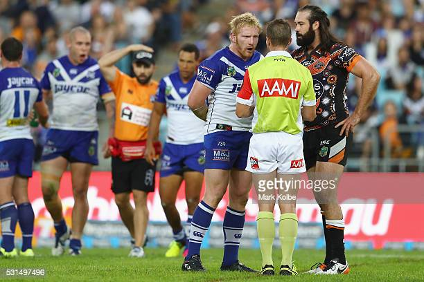 James Graham of the Bulldogs makes his point to the referee as Aaron Woods of the Tigers watches on during the round 10 NRL match between the Wests...