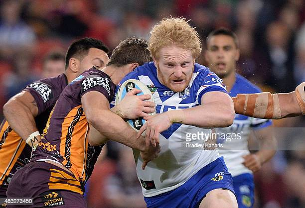 James Graham of the Bulldogs takes on the defence during the round 22 NRL match between the Brisbane Broncos and the Canterbury Bulldogs at Suncorp...