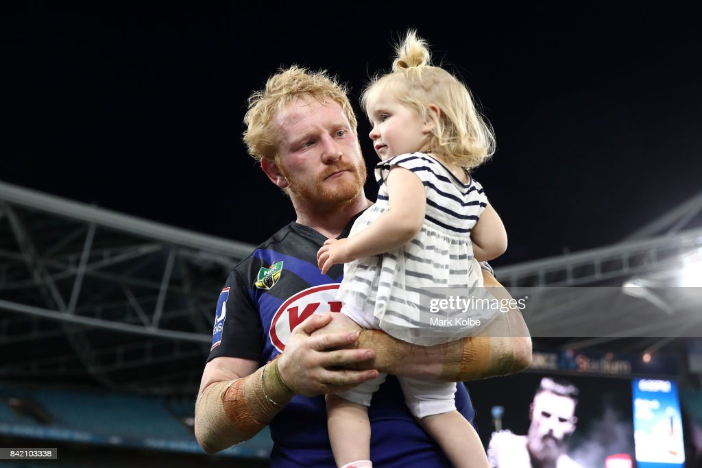James Graham of the Bulldogs walks with his daughter after the round 26 NRL match between the St George Illawarra Dragons and the Canterbury Bulldogs at ANZ Stadium on September 3, 2017 in Sydney, Australia.