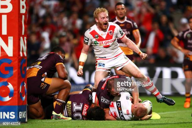 James Graham of the Dragons celebrates Jack De Belin of the Dragons scoring a try during the round one NRL match between the St George Illawarra...