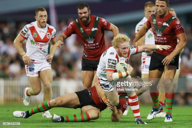 James Graham of the Dragons is tackled during the NRL trial match between the South Sydney Rabbitohs and the St George Illawarra Dragons at Glen...