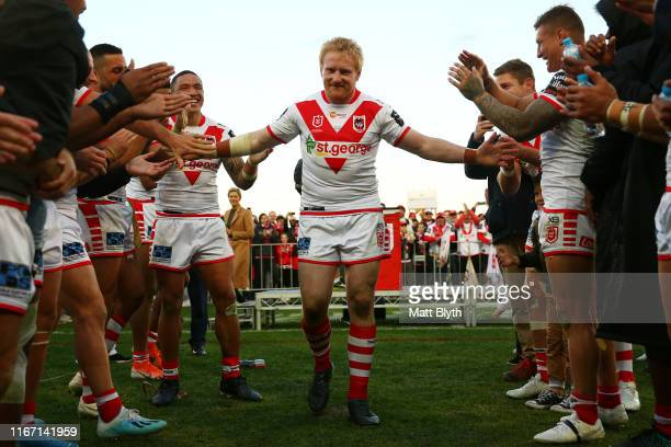 James Graham of the Dragons walks through a guard of honor from his team-mates after playing in his 400th rugby league match after the round 21 NRL...