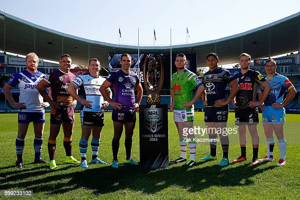 James Graham Paul Gallen Corey Parker Cameron Smith Jarrod Croker Jason Taumalolo Matt Moylan and Nathan Friend pose with the NRL Premiership Trophy...