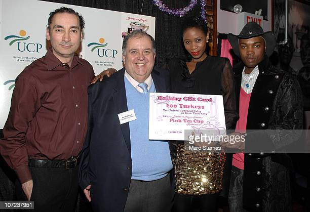 James Grant Ed Mathews Manty Toure and guest attend the 2010 Santa Project Holiday Party at The Famous Pink Tea Cup on December 1 2010 in New York...