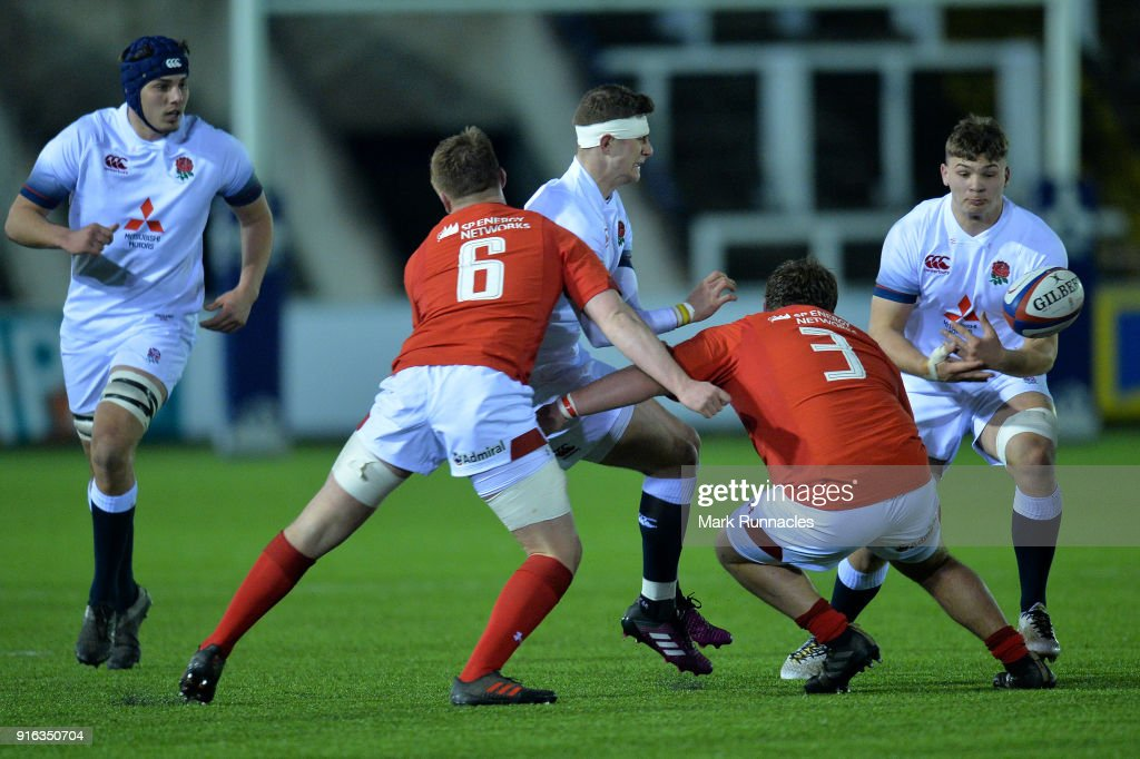 James Grayson of England off loads the ball under pressure during the RBS Under 20's Six Nations match between England U20 and Wales U20 at Kingston Park on February 9, 2018 in Newcastle upon Tyne, England.