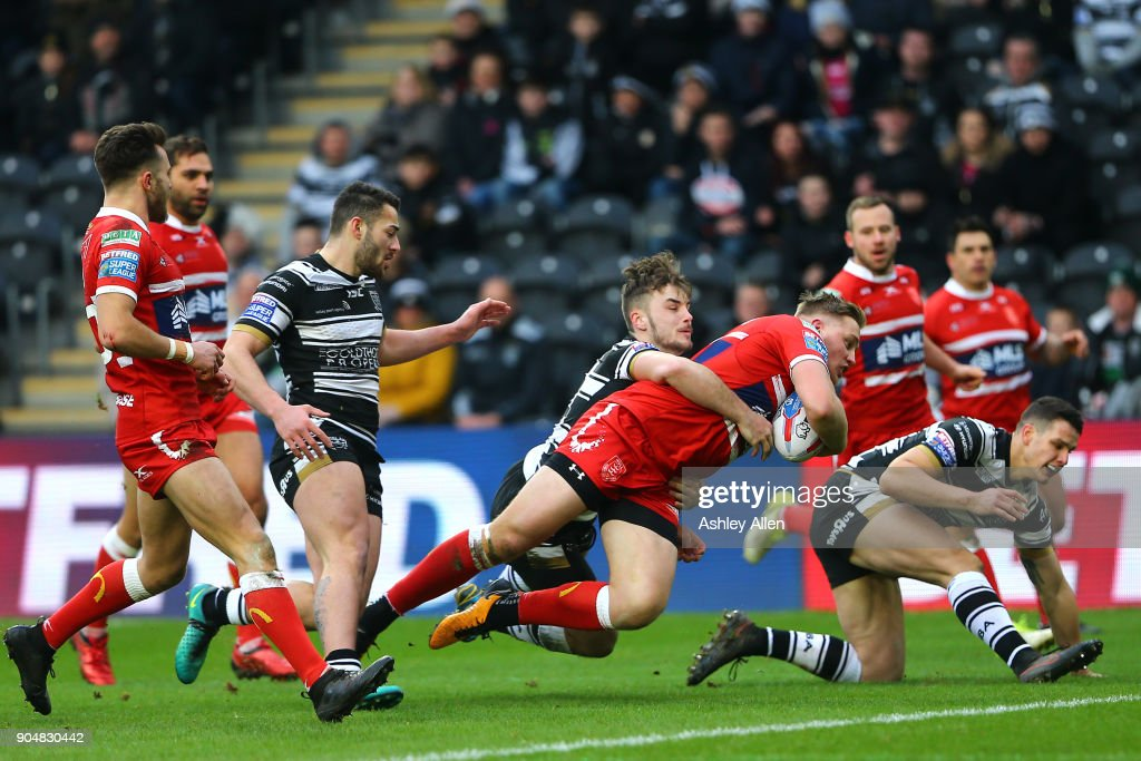 James Greenwood of Hull KR dives in for a try as Hull FC's Jack Logan tackles him during the Clive Sullivan Trophy, pre-season friendly match between Hull FC and Hull KR at KCOM Stadium on January 14, 2018 in Hull, England.