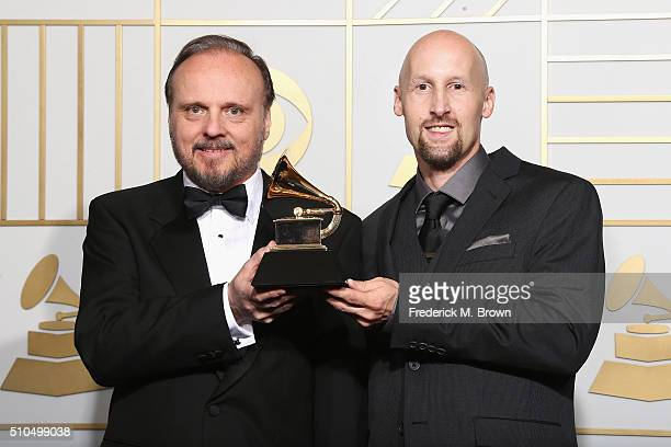 James Guthrie and Joel Plante pose with the Best Surround Sound Album award for 'Amused to Death' in the press room during The 58th GRAMMY Awards at...