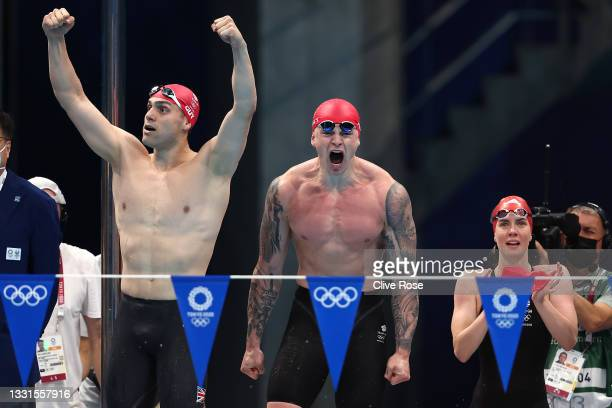 James Guy, Adam Peaty and Kathleen Dawson of Team Great Britain react during the Mixed 4 x 100m Medley Relay Final at Tokyo Aquatics Centre on July...