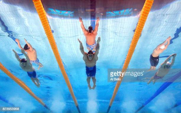 James Guy of Great Britain Caeleb Remel Dressel of the United States and Kristof Milak of Hungary compete during the Men's 100m Butterfly semi final...