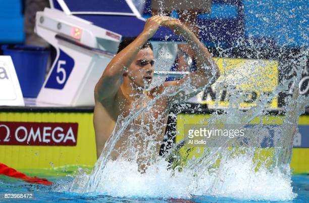 James Guy of Great Britain celebrates after winning the gold medal during the Men's 4x200m Freestyle final on day fifteen of the Budapest 2017 FINA...