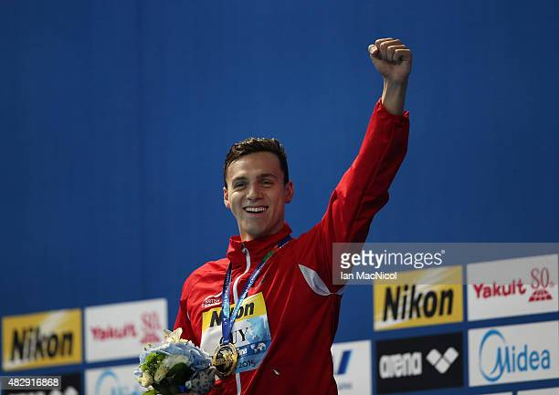 James Guy of Great Britain poses with his gold medal after winning the Men's 200m Freestyle during day eleven of The 16th FINA World Swimming...