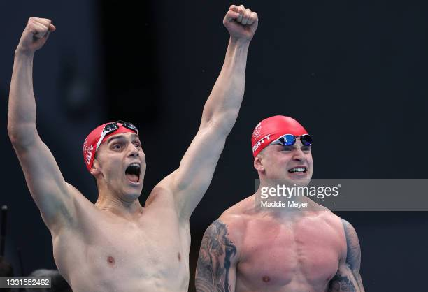 James Guy of Team Great Britain and Adam Peaty of Team Great Britain celebrate winning gold in the Mixed 4 x 100m Medley Relay Final at Tokyo...