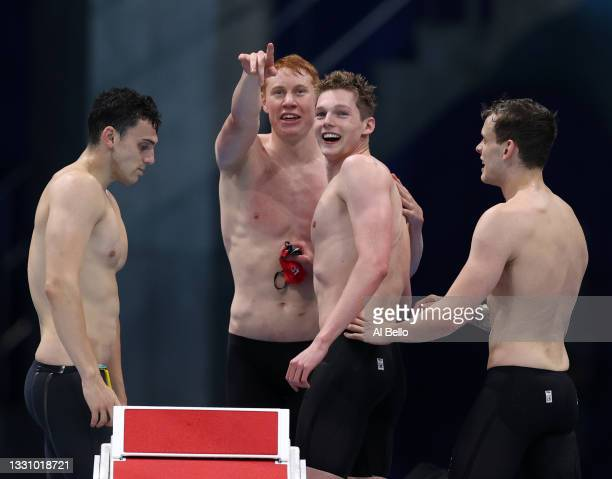 James Guy, Tom Dean, Duncan Scott and Matthew Richards of Team Great Britain celebrate after winning the gold medal in the Men's 4 x 200m Freestyle...