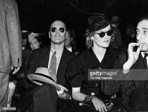James H R Cromwell and wife Doris Duke watch the fight between Joe Frazier and Max Schmeling at Yankee Stadium in BronxNew York Joe Louis won by a KO...