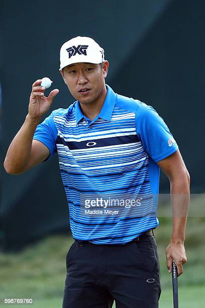 James Hahn acknowledges the crowd on the ninth green during the first round of the Deutsche Bank Championship at TPC Boston on September 2 2016 in...