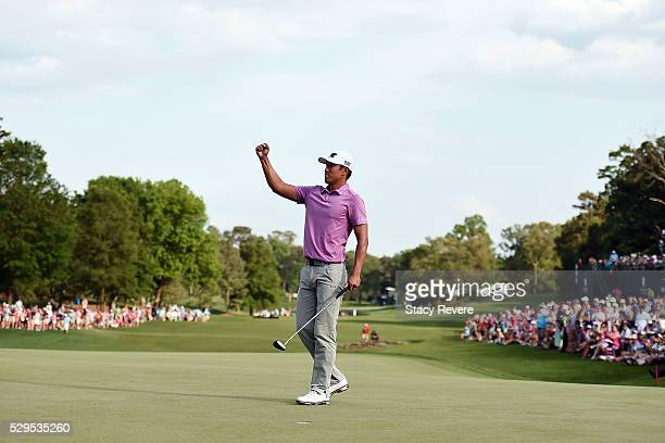 James Hahn celebrates after winning the Wells Fargo Championship on the first playoff hole at Quail Hollow Club on May 8 2016 in Charlotte North...