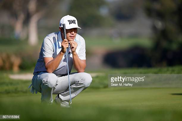 James Hahn lines up a putt on the 2nd green during Round 2 of the Farmers Insurance Open at Torrey Pines North on January 29 2016 in San Diego...