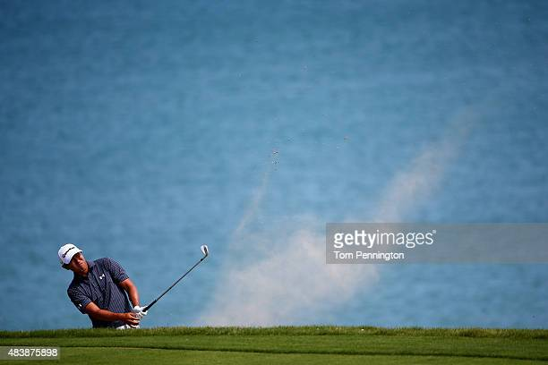 James Hahn of the United States plays a bunker shot on the 16th hole during the first round of the 2015 PGA Championship at Whistling Straits on...