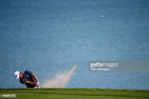 James Hahn of the United States plays a shot from a bunker on the 16th hole during the first round of the 2015 PGA Championship at Whistling Straits...