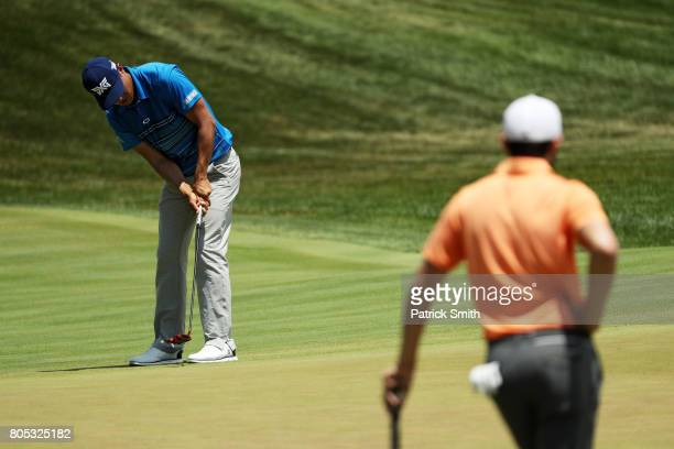 James Hahn of the United States putts as Kyle Stanley of the United States watches on the seventh green during the third round of the Quicken Loans...