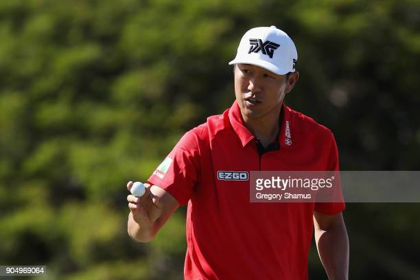 James Hahn of the United States reacts after a birdie putt on the 15th green during the final round of the Sony Open In Hawaii at Waialae Country...