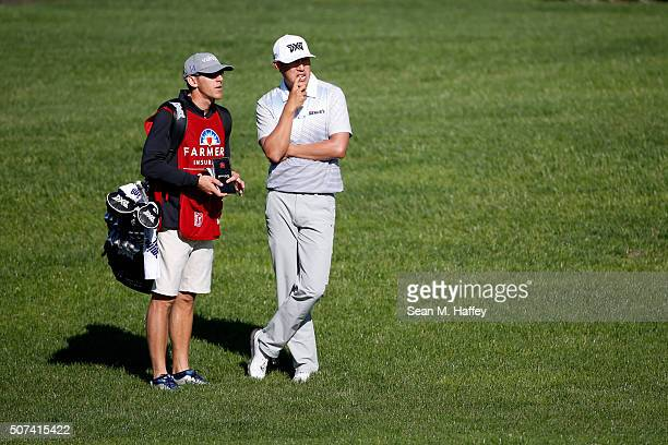 James Hahn talks to his caddie on the 2nd fairway during Round 2 of the Farmers Insurance Open at Torrey Pines North on January 29 2016 in San Diego...
